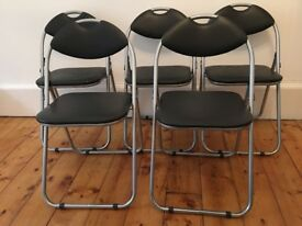 5 black padded metal folding chairs £40 or £10 each. Comfy, compact, and easy store