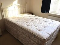 Double Bed Divan with 4 Drawers and Metal Headboard at Horsham
