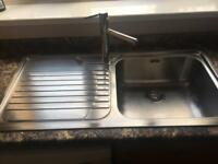 Stainless steel kitchen sink and mixer tap