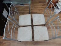 Glass and Metal Dining Table and 4 Metal and Fabric Chairs
