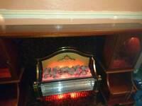 electric fireplace with lit Dvd/bookshelf