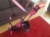 Girls pink trike, good condition, comes with all the original accessories.