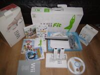 Nintendo Wii with Wii fit board and extras