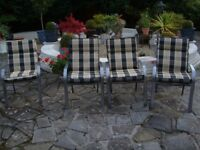 SET OF 4 PATIO CHAIRS WITH DEEP PADDED CUSHIONS IN VERY GOOD CONDITION COST £180 BARGAIN £60