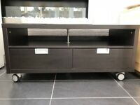 Ikea TV bench in black/brown. 2 drawers. 120cm wide 55cm high x 60cm deep.