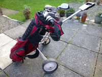 USED SET OF GOLF CLUBS IN STAND BAG, MIX OF STANLEY ROGERS AND DUNLOP