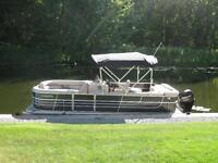 Pontoon Boat For Sale with trailer.