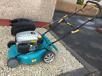 Brand new petrol lawnmower. Never used.