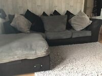 Grey and black corner sofa with foot stool