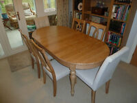 Solid oak table and Six Chairs. Extends to seat 8. Can offer free transport in Bristol/S.Glos area.