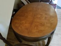 Solid wood extending dining table with 6 chairs and 2 carvers.