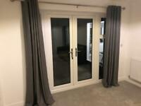 Grey curtains from Dunelm with curtain pole