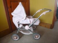 Baby Annabell dolls pram with detachable carry cot and baby bag