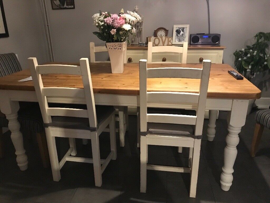 6ft table with chalk painted legs and chairs. Great condition excellent shabby chic project