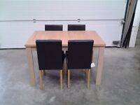 New extendable dining table with either 4 06 6 chairs. Bargain, boxed, can deliver.