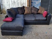 Fantastic black corner sofa with lovely cushions. Brand New in the Box. can deliver