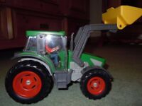 SCHLEICH FARM TRACTOR with DRIVER #42052 (retired)