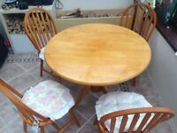 Round wooden table and four chairs