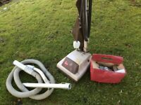 Vintage old Hoover, with some Hoover parts, and Cordless Vacuum