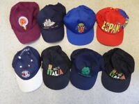Group of 34 men's caps bought while on holiday