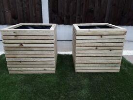 Modern timber planters. Garden yard