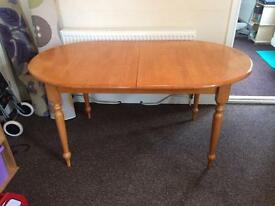 Solid wooden dining table - extendable
