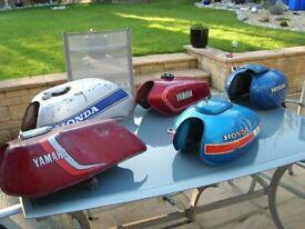 COLLECTION OF VINTAGE MOTORBIKE PETROL TANKS,,YAMAHA RD,HONDA ETC