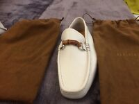 White Gucci loafers