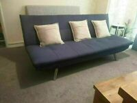 CLICK SOFA BED MADE IN FABRIC IN COLOUR BLUE NICE STYLE WITH SILVER FRONT LEGS GOOD CONDITION