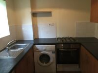 very large purpose built studio flat near all aminities, allocated parking.