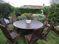 Large wooden table (converts smaller) and 8 folding chairs