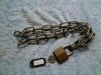 2 padlocks and chains