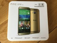 HTC ONE (m8) gold mobile phone and accessories