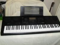 Casio WK-7600 keyboard , original manual ,power supply and music rest..