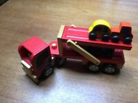 Wooden car transporter with four cars. From smoke and pet free home