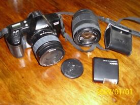 SLR camera with 2 zoom lenses