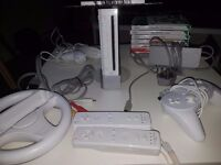 Nintendo Wii with 3 contollers (one wired), wheel and 8 games