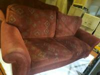 2 × 3 seater red fabric sofas