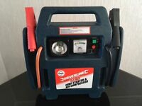Portable jump starter with air compressor
