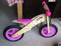 Girls wooden balance bike in pink with spare tire