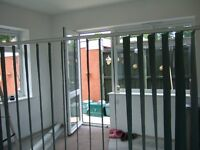 DARK GREEN VERTICAL BLACKOUT BLINDS,WITH TRACK & FIXINGS,IN GOOD USED CONDITION.