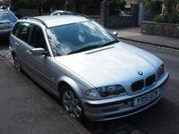 Silver BMW 320i SE Touring Estate, Petrol