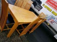 Light oak table and 6 chairs with black leather seating