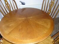 SOLID OAK ROUND FARMHOUSE TABLE & 4 CHAIRS FOR SALE.
