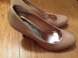 Beige high heeled shoes