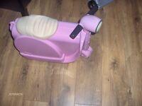 kids skoot ride on motorbike suit case pink.