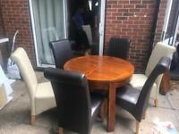 Extending Dining Table and 6 Leather Chairs