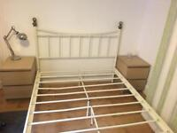 Metal frame cream bed double.