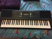 Yamaha PSR E343 keyboard, stand and music books. Recommended by all keyboard teachers.