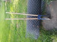 chainlink fence/posts/post hole digger